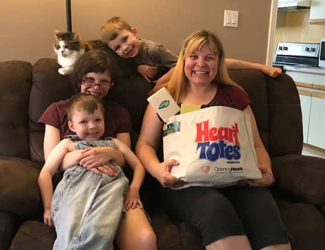 Family receiving a Heart Tote